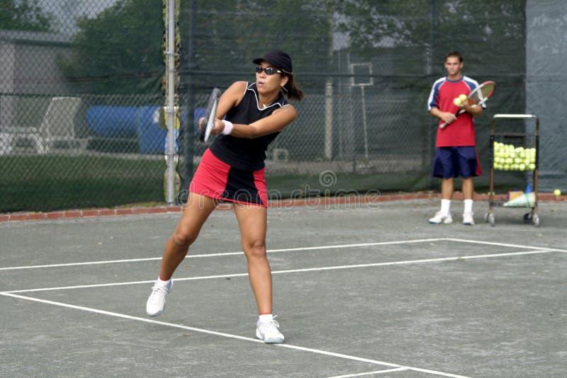 Lição de tênis imagens de stock