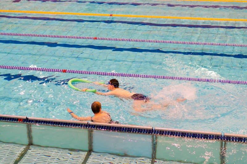 Lições da natação foto de stock royalty free
