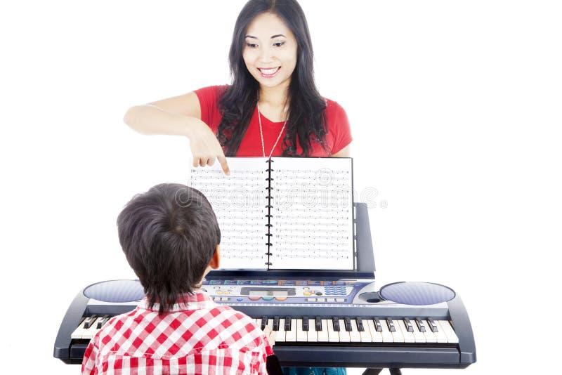 Lições de piano foto de stock royalty free