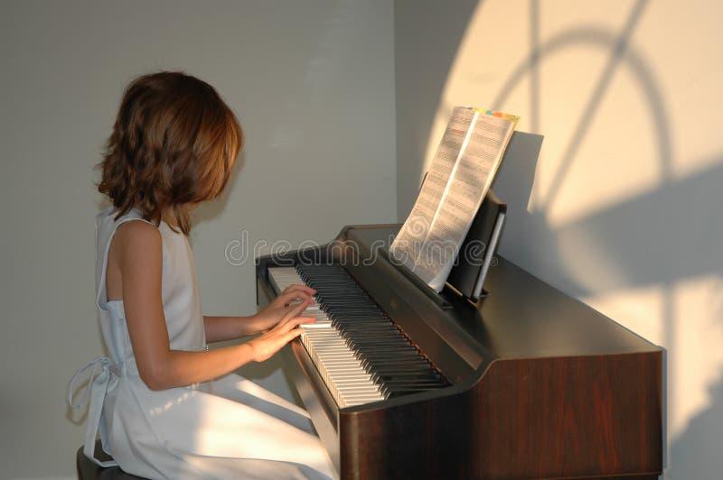 Lições de piano imagens de stock