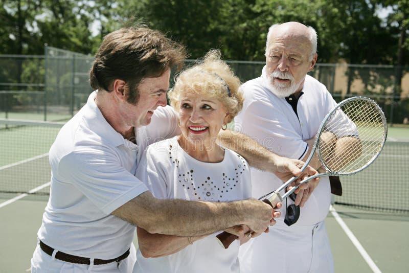Lições de tênis - Husba ciumento fotos de stock royalty free