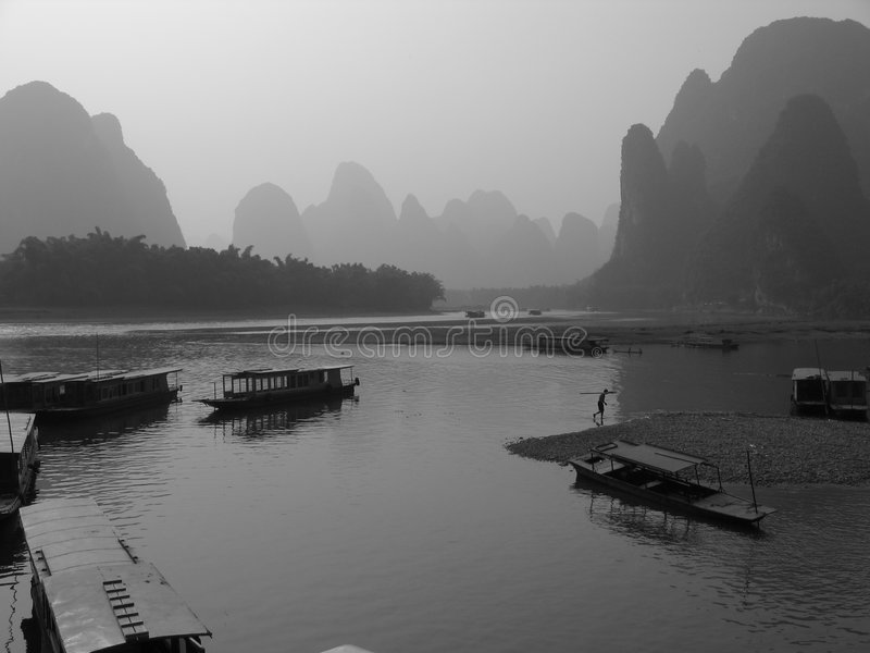 Li River at dusk. Fisherman boats on the Li River in yangshuo near Guilin, China royalty free stock photography