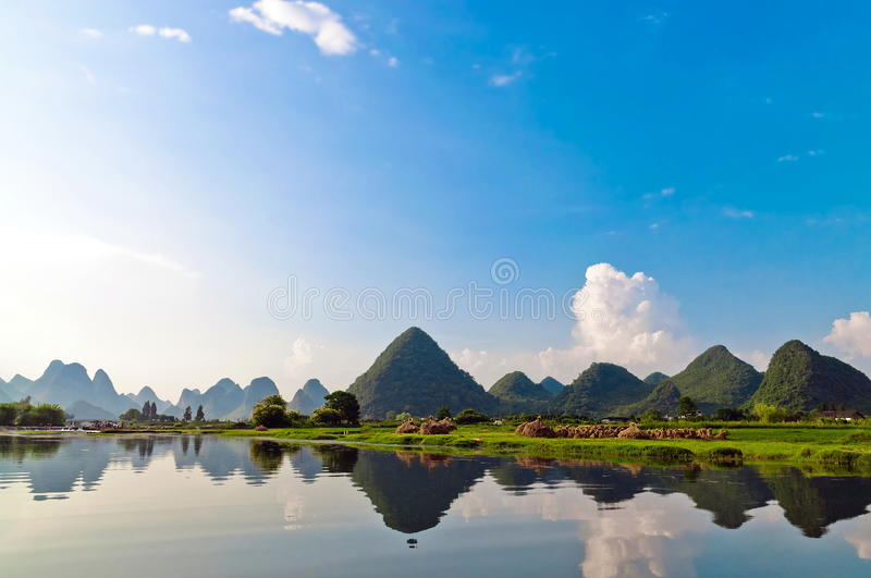 Li river in Yangshuo. Reflection of the muntains in Li River landscape in morning light, Yangshuo near Guilin stock images