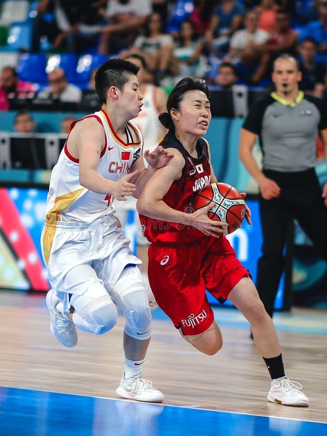 Li Yuan and Nako MotoHashi in action during basketball match CHINA vs JAPAN stock photo
