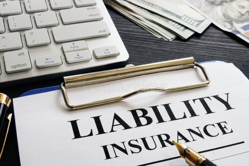Liability insurance agreement on the desk. Liability insurance agreement on a desk stock image