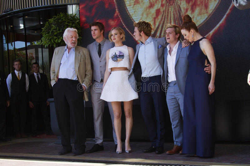Liam Hemsworth Jennifer Lawrence, Sam Claflin royaltyfria bilder