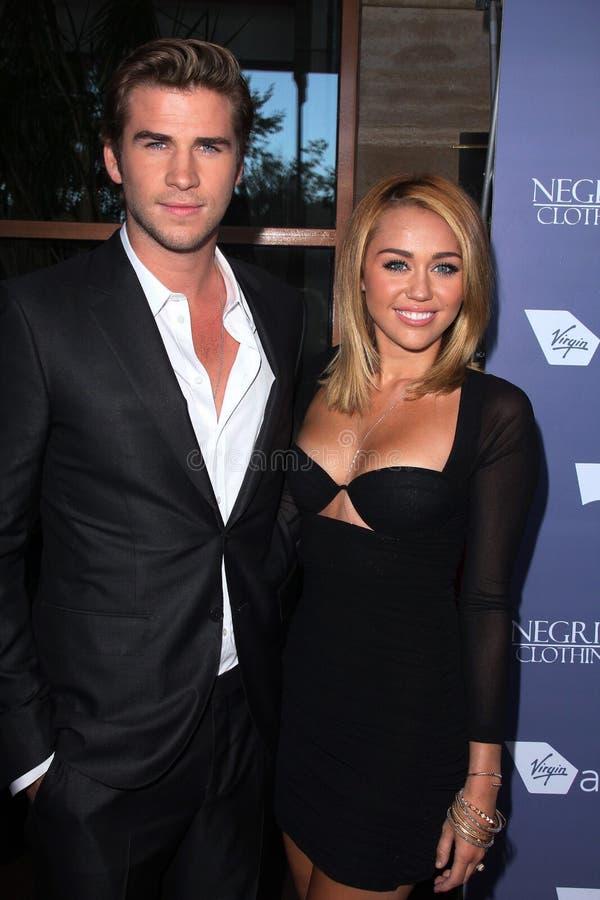 Liam Hemsworth, Miley Cyrus aux Australiens dans les 8èmes récompenses annuelles de découverte de film, hôtel intercontinental, vi photo stock