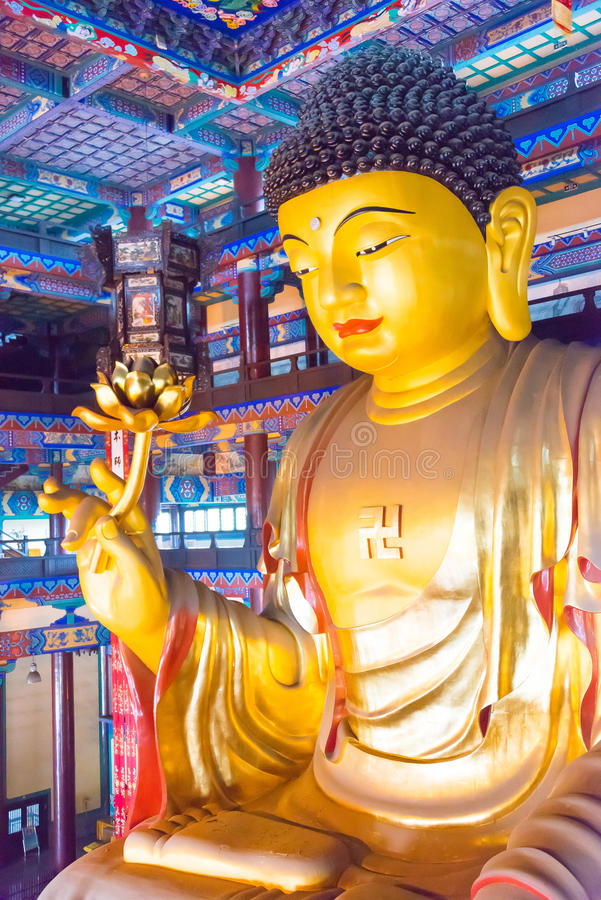 LIAONING, CHINA - Aug 03 2015: Budda statue at Guangyou Temple S. Cenic Area. a famous historic site in Liaoyang, Liaoning, China stock photo