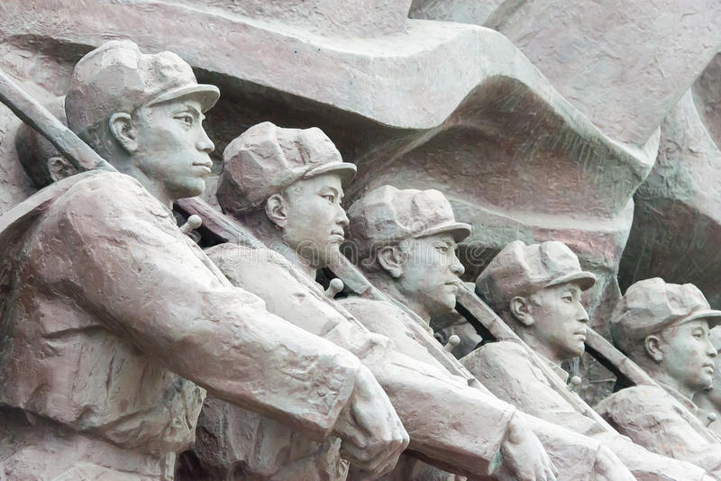 LIAONING, CHINA - Jul 28 2015: Chinese People's Volunteer Army S. Tatues at Yalu River Short Bridge. a famous historic site in Dandong, Liaoning, China stock photo