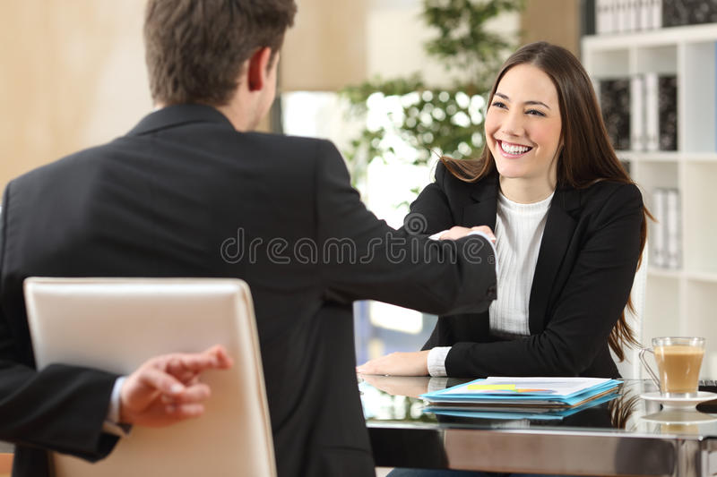 Liar businessman closing a deal royalty free stock image