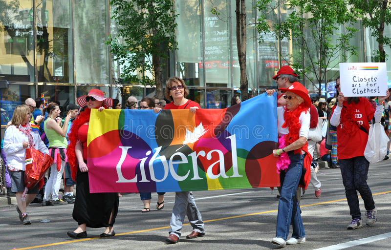 Liberal pride. Members of the Liberal party carrying the pride flag at Edmonton's pride parade royalty free stock photo
