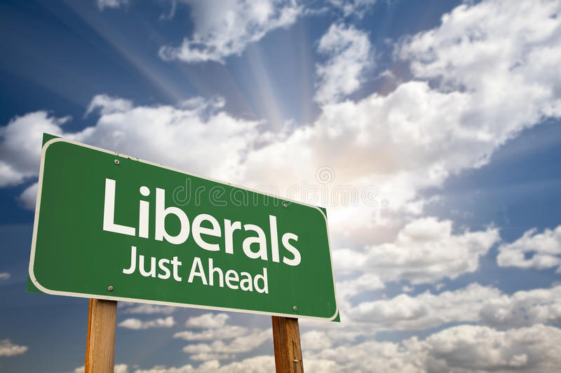 Liberals Green Road Sign and Clouds. Liberals Green Road Sign with Dramatic Clouds, Sun Rays and Sky stock images