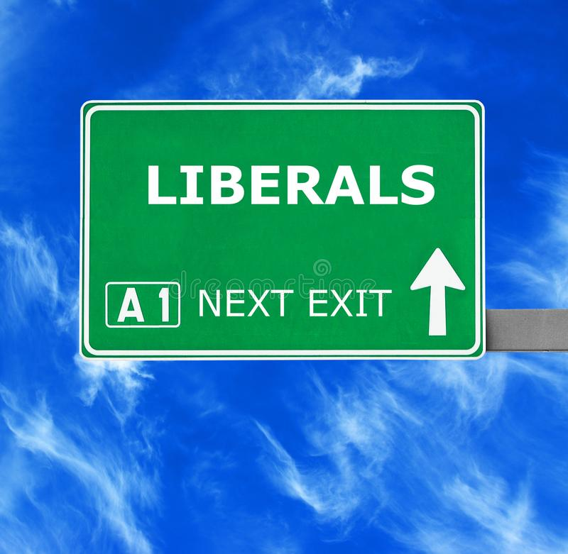 LIBERALS road sign against clear blue sky stock photo
