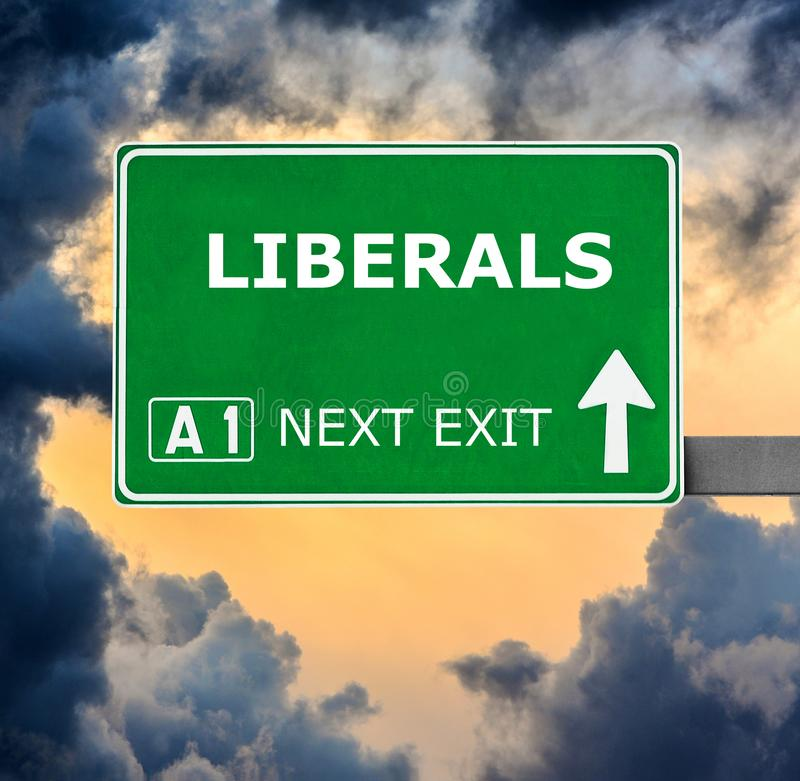 LIBERALS road sign against clear blue sky stock image