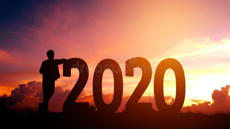 Liberdade do homem novo da silhueta do ano 2020 novo e conceito do ano novo feliz foto de stock royalty free