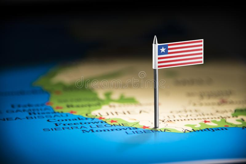 Liberia marked with a flag on the map stock image