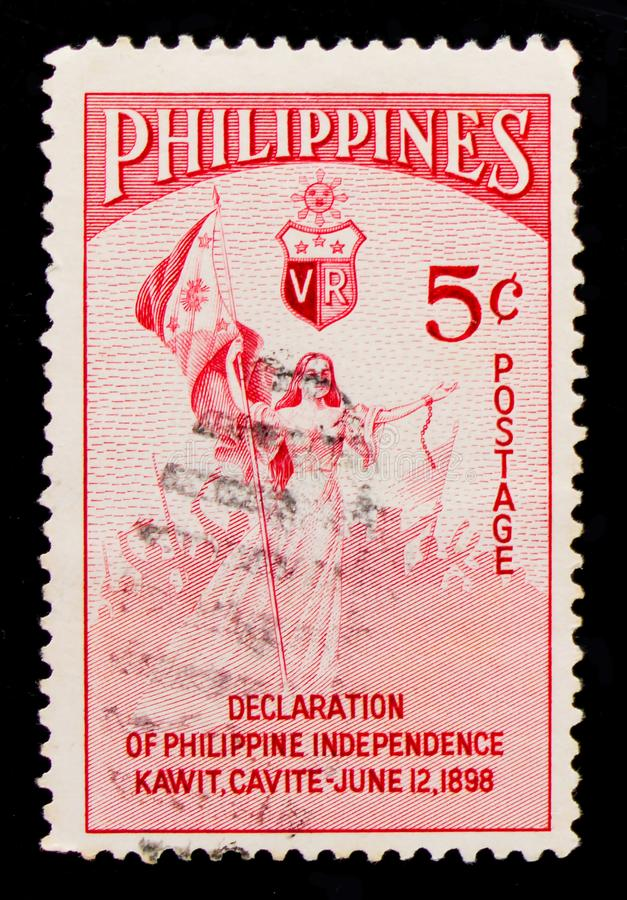 Libertà con la bandiera nazionale, dichiarazione del serie filippino di indipendenza, circa 1954 fotografie stock libere da diritti