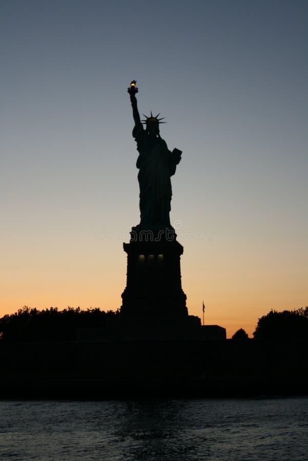 Liberté au coucher du soleil photographie stock