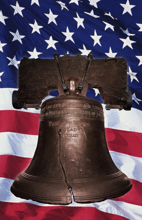 Liberty Bell with American flag stock photography