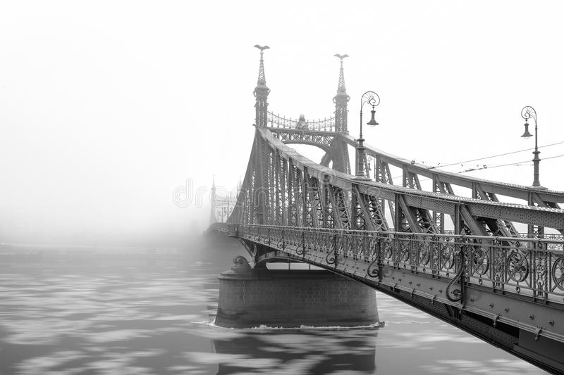 Liberty Bridge in a foggy Morning, Budapest royalty free stock photography