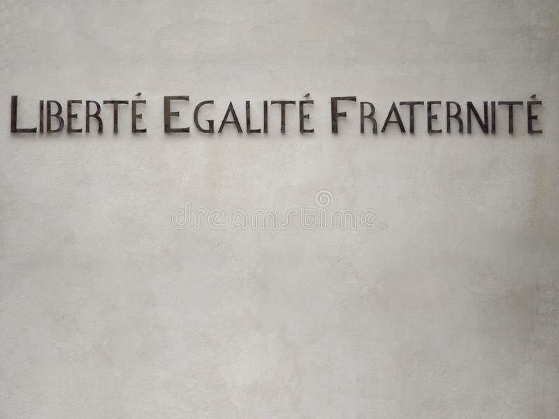Liberty, Equality, Fraternity. The motto of the French revolution on the wall of Hotel de Ville in Saint Remy de Provence stock photos