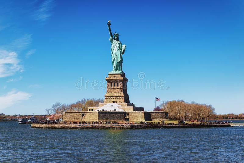 Liberty Island and Statue in New York. Liberty Island and Statue in Upper New York Bay in New York City, USA. In Upper New York Bay. Tourists are walking on the royalty free stock photography
