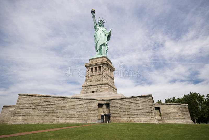 Liberty Statue. With clouds in the background in a sunny day - New York USA 2007 royalty free stock photo