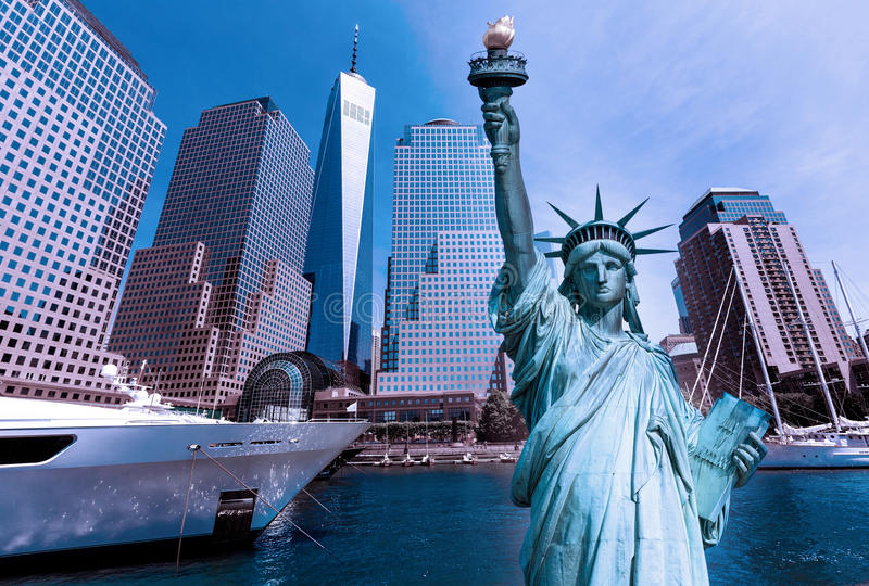 Liberty Statue and New York skyline US stock photos