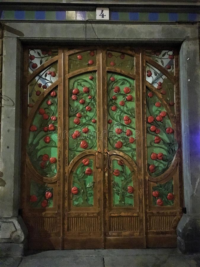 Liberty style door, Art Nouveau in Turin city, Italy. Art, history, time, luxury, crativity, imagination, craftsmanship, pomegranate door and fascination in royalty free stock image