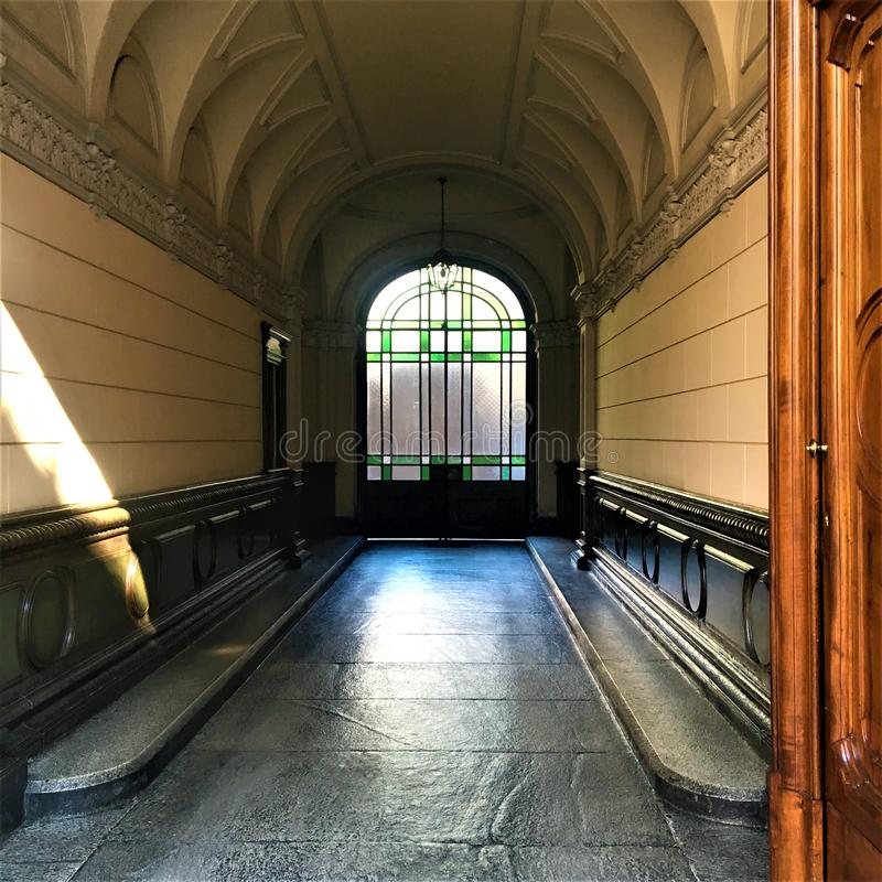 Liberty style entrance hall in Turin, Piedmont region, Italy. Art, history and time. Architecture and design, decoration and fascination, wood and stones, door stock image