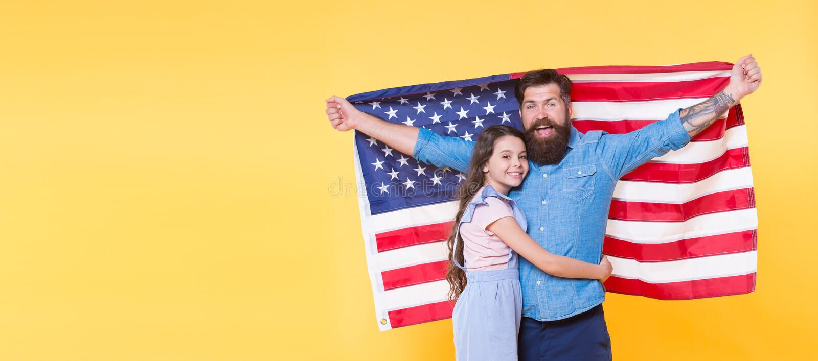 Liberty for you and me. How do americans celebrate independence day. Father american bearded hipster and cute little. Daughter with USA flag. Independence is stock images