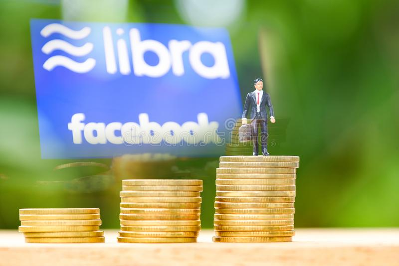 Libra coin blockchain concept / New project libra a cryptocurrency launched by Facebook and businessman on coin staircase stock photo