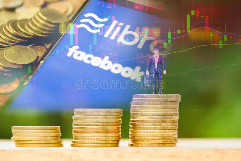 Libra coin blockchain concept / New project libra a cryptocurrency launched by Facebook stock graph charts coin businessman stock illustration