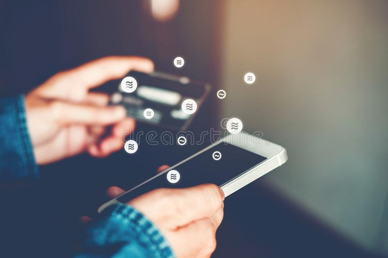 Libra Cryptocurrency Online banking businessman using smartphone with credit card Fintech and Blockchain concept.  royalty free stock photography