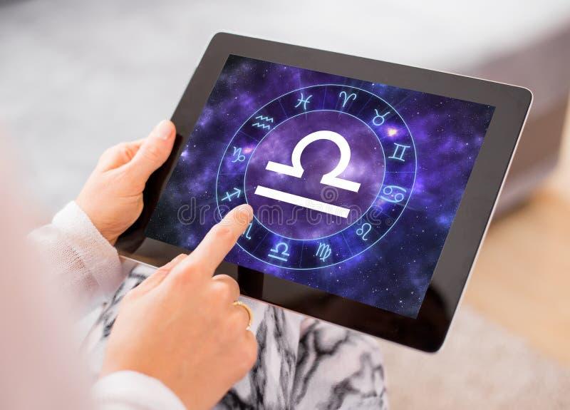 Libra zodiac sign. On tablet stock photo