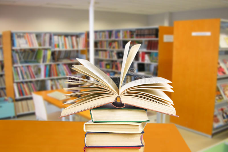 Library. The books lay on a table in library royalty free stock photography
