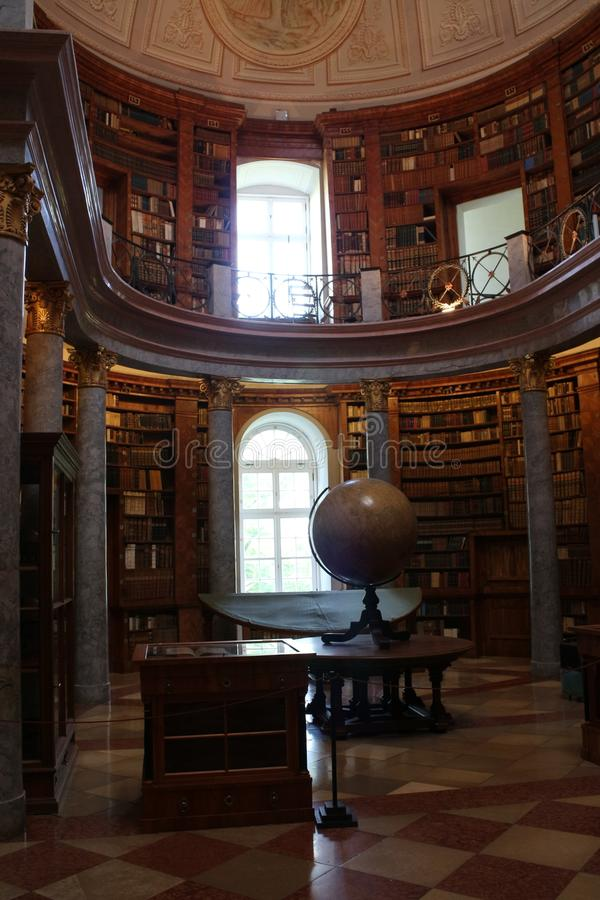 Library in The Benedictine Pannonhalma Archabbey with globe stock image