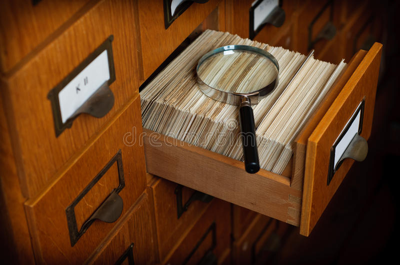 Library Card Catalog Search Concept. Library card catalog and magnification glass - Search Concept royalty free stock images