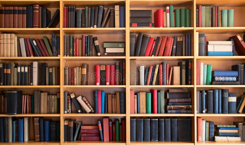 Library bookcase. Library interior, bookcase with old books on the shelves stock photos