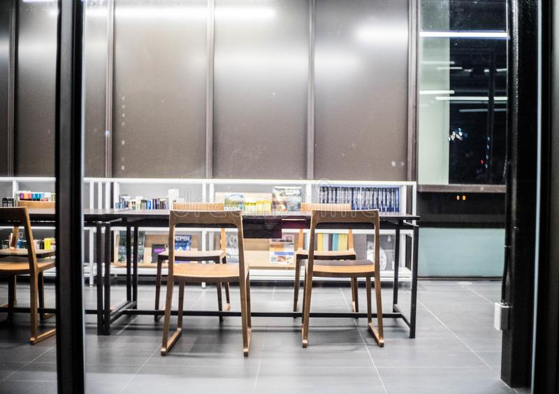Bangkok - June 5,library interior,library setting with books,table ,many chair and reading material on white shelf at TCDC Library royalty free stock image