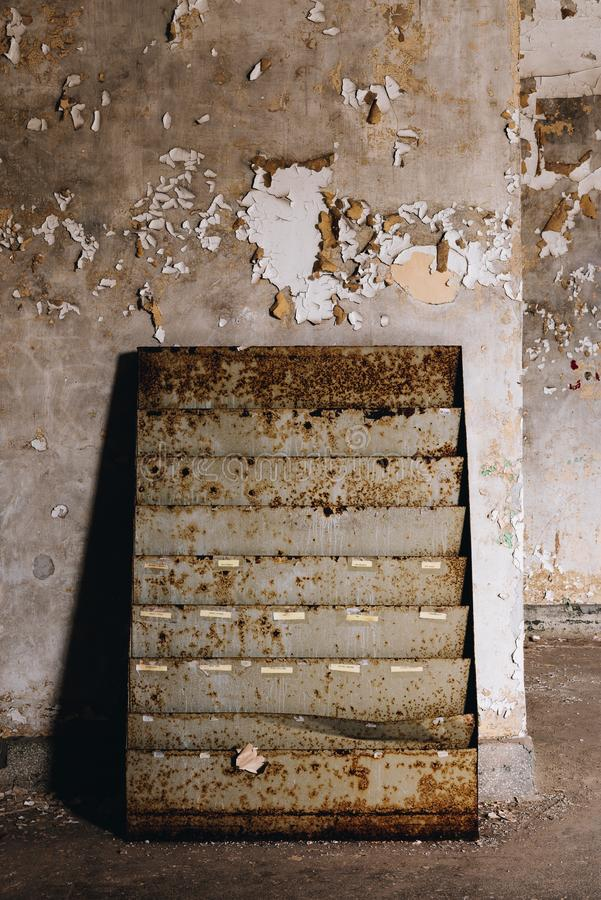 Library Magazine Rack - Ohio State Reformatory Prison - Mansfield, Ohio. A view of a derelict magazine rack at the library inside the closed Ohio State stock image