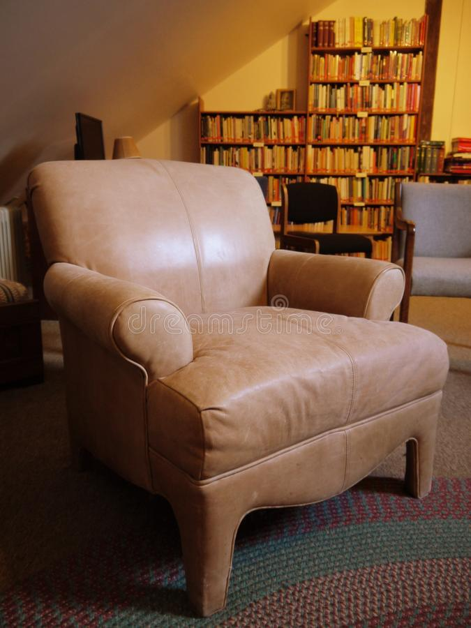 Library: old leather armchair royalty free stock image