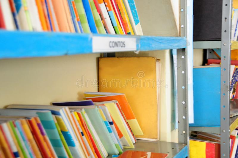 Library shelf with several books royalty free stock photography