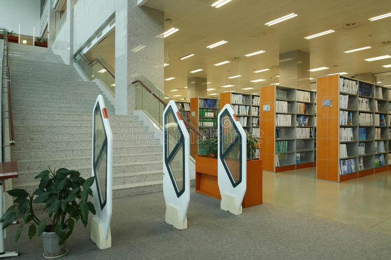 The library. To read books in  reading structure learning self-study university modern buildings growing middle school high school desk bookcase bookshelf stock image
