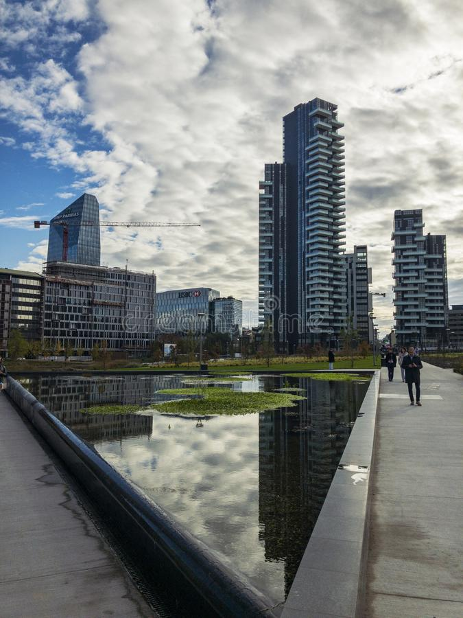 Library of trees, new Milan park. Solaria tower, Diamond tower. Skyscrapers mirrored in the fountain. Italy. Library of trees, new Milan park. Solaria tower. 11/ stock photography
