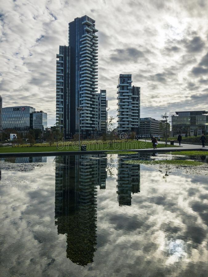 Library of trees, new Milan park. Solaria tower. Skyscrapers mirrored in the fountain. Italy. Library of trees, new Milan park. Solaria tower. 11/07/2018. Paths stock image