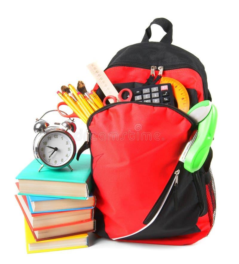 Libri, accessori della scuola e uno zaino immagine stock libera da diritti