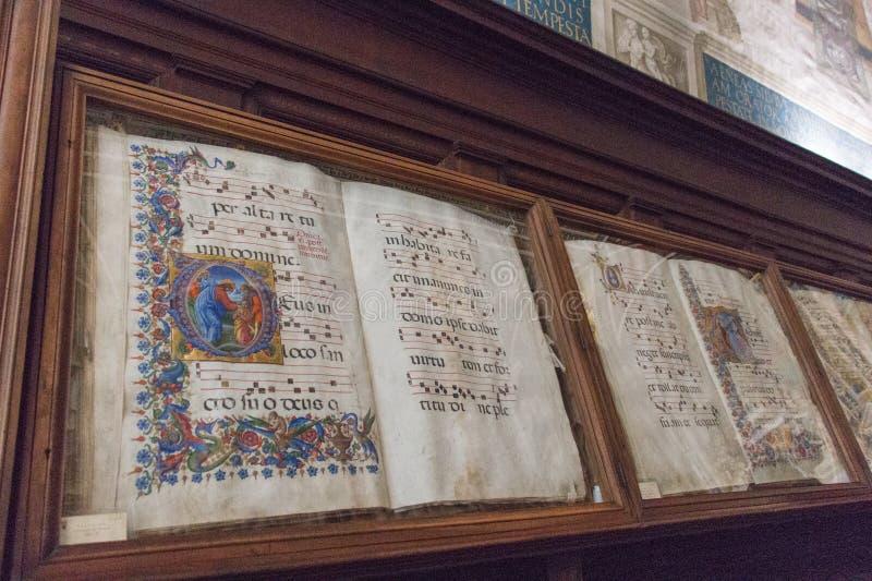 Libri antichi in biblioteca Piccolomini di Siena Cathedral Duomo, Siena, Toscana, Italia immagini stock libere da diritti