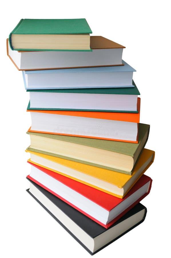 Libri colorati su priorità bassa bianca fotografia stock libera da diritti