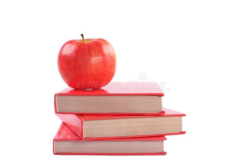 Libri con la mela fotografie stock